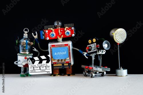 Fotografia, Obraz  Robotic filmmaker cameraman, assistant with clapperboard behind the scene motion picture Robots