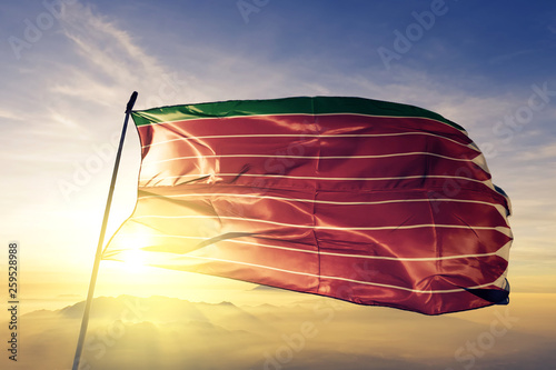 Zamora province of Spain flag waving on the top sunrise mist fog
