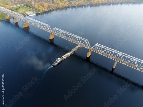 Fotografia  Scenic aerial cityscape of Kiev and river Dnipro at sunset