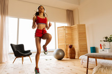 Woman With Sport Body Moving And Dancing In Earphones