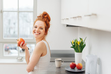 Happy Healthy Young Woman Eating Fresh Fruit