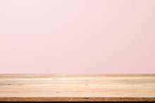 Empty Wooden Deck Table Over Rusty Pink Background For Present Product.