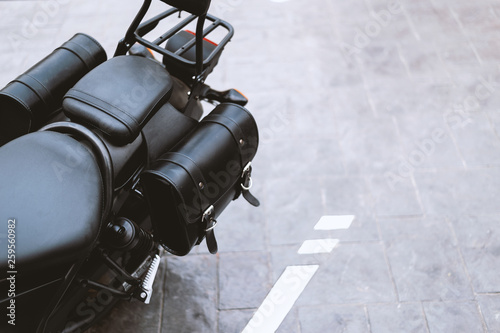 Fotografiet  closeup of a black leather bag in motorcycle touring with soft-focus and over li