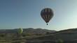 Cappadocia / Turkey- May 24 2018: balloons over the mountains