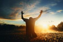 Man Raising His Hands In Worship