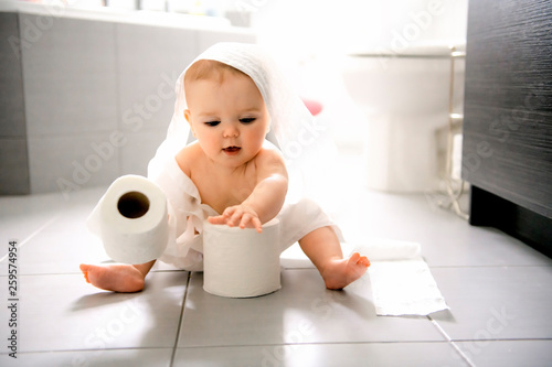 Toddler ripping up toilet paper in bathroom Wallpaper Mural