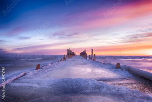 Fotobehang Noord Europa Winter seascape of wood breakwaters on frozen Baltic sea