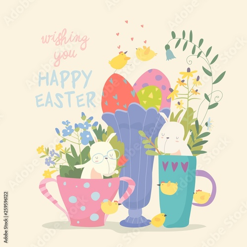 Cute little bunny in a cup. Rabbit in a mug with flowers and eggs