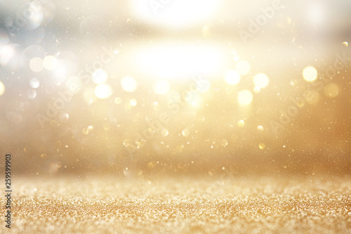 Fototapeta photo of gold and silver glitter lights background obraz