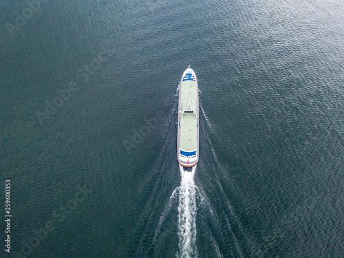 Obraz na płótnie Aerial view of passenger ferry ship cruising on a lake in Switzerland