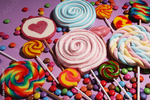 Fotobehang Snoepjes lollipop candies with jelly and sugar. colorful array of different childs sweets and treats on color background