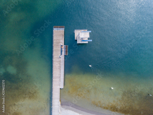 Garden Poster Shipwreck Aerial view of lakeside beach with no people. Beautiful seafloor under water.