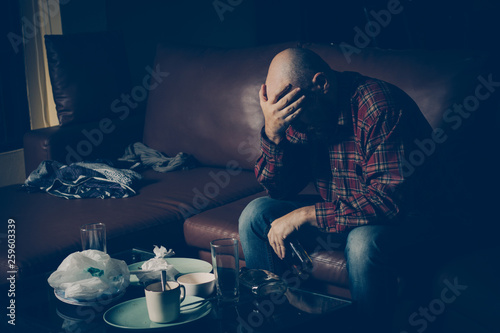 Photo Drunk man on the sofa. Alcoholism, alcohol addiction, drug addic