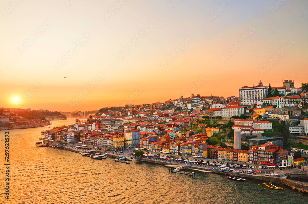 Magnificent sunset over the Porto city center and the Douro river, Portugal. Dom Luis I Bridge is a popular tourist spot as it offers such a beautiful view over the area.