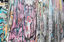 Close-up Of Graffiti At The East Side Gallery, Section Of The Berlin Wall In Berlin, Germany.