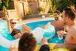 Friends at a poolside party