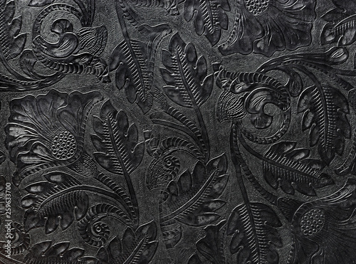 Fotografia, Obraz  Embossed shiny black leather with the floral motif
