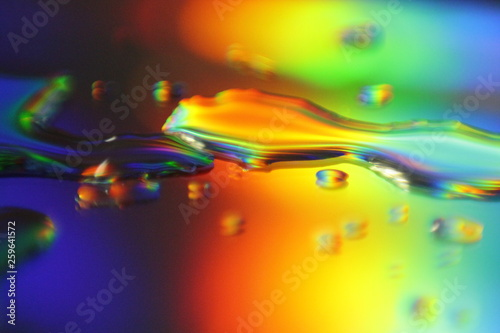 Valokuva  abstract colorful background with holographic liquid splash and droplets