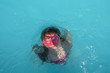 Girl surfacing from diving in swimming pool