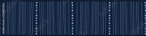Tuinposter Fantasie Landschap Indigo blue hand drawn vertical striped lines seamless border pattern. Sketchy dotty vector illustration. Modern graphic design, denim ribbon trim, asian fusion style. Playful masculine background.