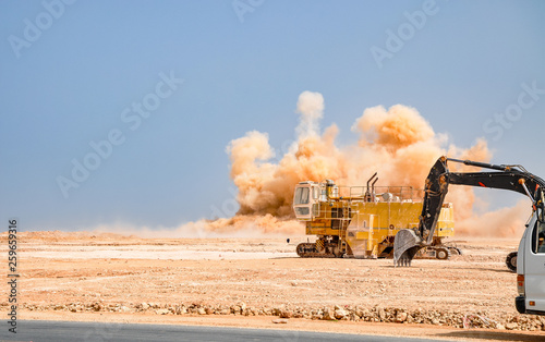 Valokuva  Heavy construction machinery and the detonator blasting on the site