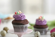 Dessert Stand With Sweet Easter Cupcake On Blurred Background