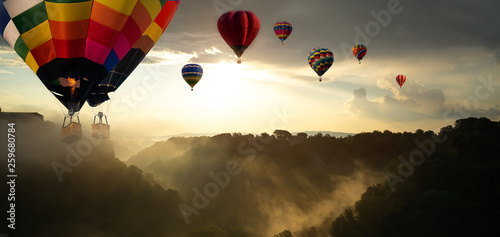 Poster Balloon Beautiful panoramic nature landscape of countryside mountains with colorful high hot air balloons festival in summer sky. Vacation travel panorama background.