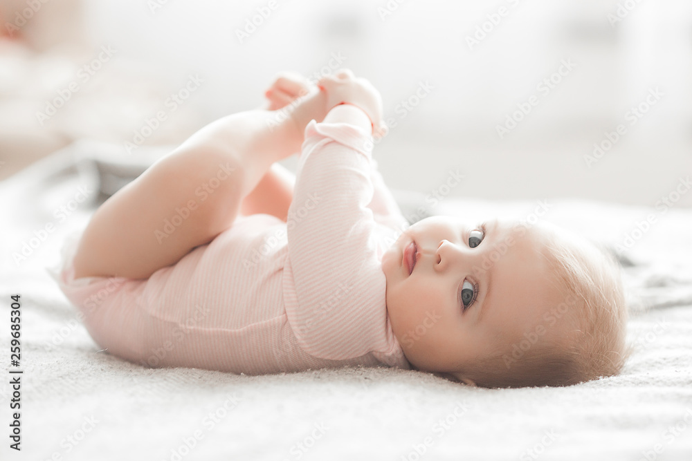 Fototapety, obrazy: Adorable little baby portrait. Cute baby girl indoor. 6 month child smiling.