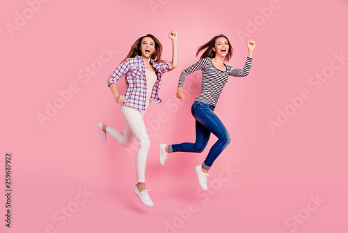Full length body size view photo of active energetic excited ladies funny enjoy funky laughing laughter having strolls dressed in modern shirts denim trousers isolated on rose-colored background - 259687922