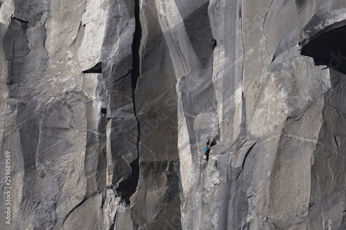Climbers attempt to climb jagged granite of El Capitan in Yosemite National Park - 259689569