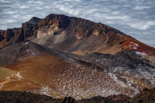Aerial View Of Crater Over The Clouds