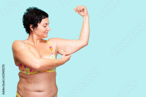 Valokuva Unintentional Woman pinching Arm Fat Flabby Skin, Hand and Body Care