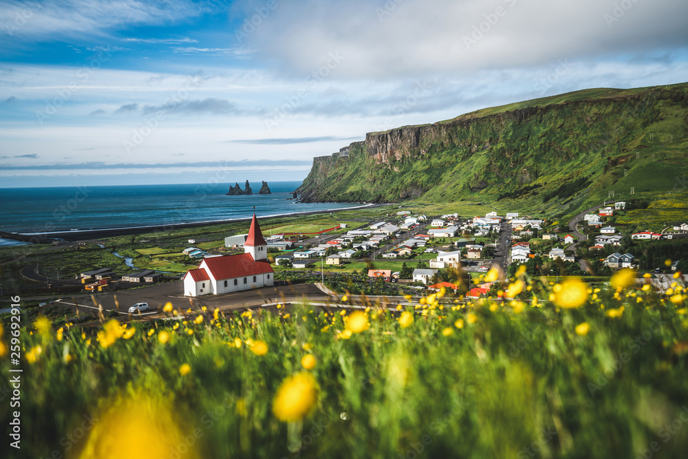 Fototapeta Beautiful town of Vik i Myrdal in Iceland in summer. The village of Vik  is the southernmost village in Iceland on the ring road around 180 km southeast of Reykjavík.