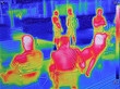 canvas print picture - Infrared thermovision image showing when People sit at the table in the summer
