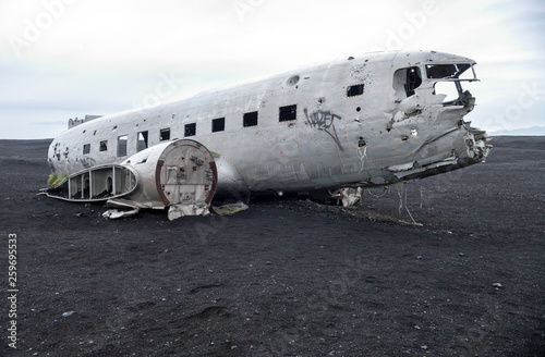 Photo  Wreckage of crashed airplane Dakota United States Navy Douglas Super DC-3 on the coast of iceland black sand beach
