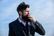 I made my decision. Businessman against the sky. Future success. Male formal fashion. Bearded man smoking cigarette. smoke. brutal caucasian hipster with moustache. Mature hipster with beard