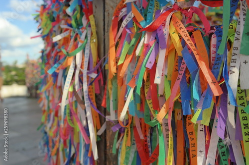 Fotoposter Paradijsvogel bloem Igreja de Nosso Senhor do Bonfim, a catholic church located in Salvador, Bahia in Brazil. Famous touristic place where people make wishes while tie the ribbons in front of the church. Carnival land.