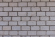 The brick texture, wall, with cracks and scratches can be used as a background