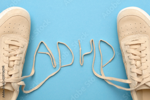 Women sneakers with laces in adhd abbreviation text. Wallpaper Mural