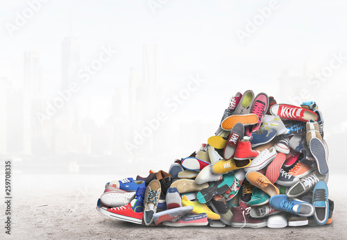 Fotografia  Big sneaker made up of different sneakers