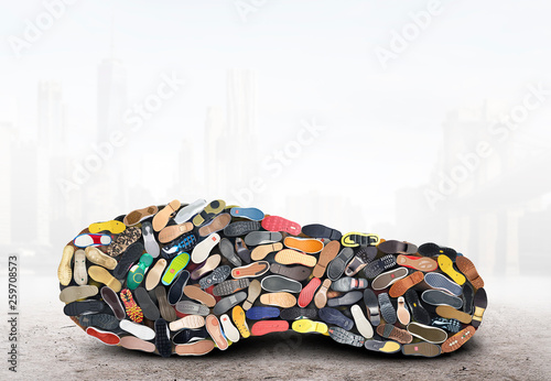 Obraz Big sneaker made up of different sneakers - fototapety do salonu