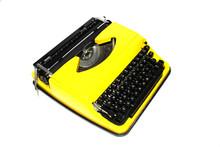 Retro Yellow Typewriter On A White Background