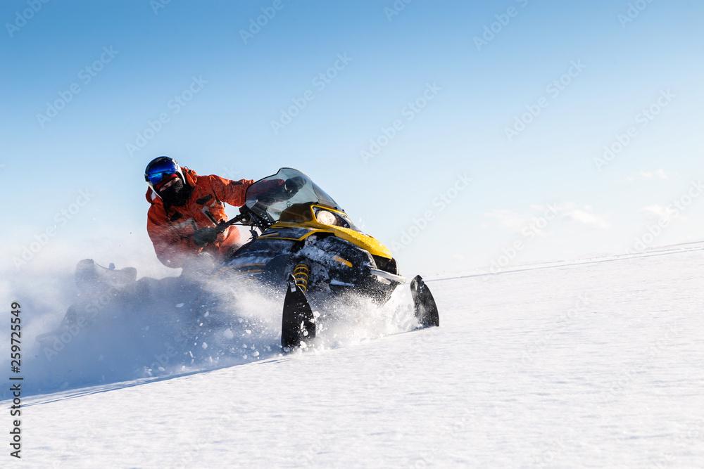 Fototapety, obrazy: Athlete on a snowmobile.