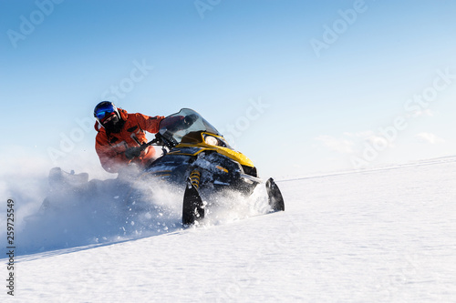 Photo Athlete on a snowmobile.