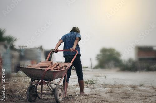 Fotografie, Obraz Child labor in building commercial building structures