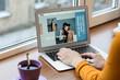 Leinwandbild Motiv Female fashion blogger working on laptop near window