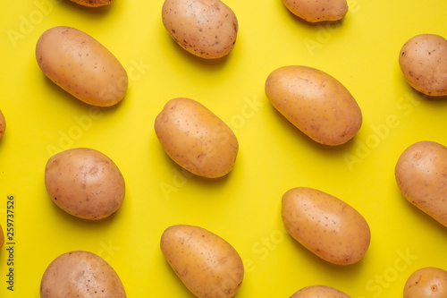 Vászonkép Raw potato on color background