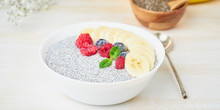 Banner With Chia Pudding In Bowl With Fresh Berries Raspberries, Blueberries. Side View, White Wooden Light Background.