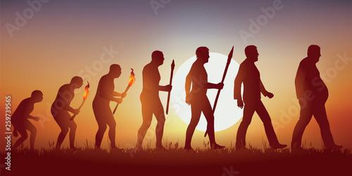 Fototapeta Concept de l'obésité et de la mauvaise alimentation avec le symbole de Darwin montrant l'évolution de l'homme primitif vers l'homme moderne, aboutissant à un homme en surpoids qui marche péniblement. obraz