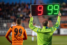 Referee Shows Players Substitu...